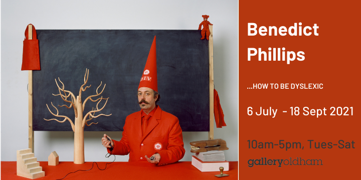 Slider advertising Benedict Phillips exhibition from 6 July showing Benedict in front of blackboard with Div hat