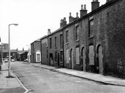 A street in Oldham in 1974, the year Len Johnson died. You can clearly see racist graffiti on one of the houses.