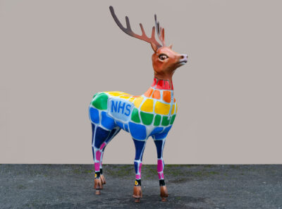 Reindeer sculpture with NHS and rainbow colours.