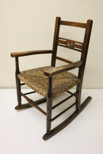 Scaled-down children's rocking chair which belonged to a little boy who lived at the 'Telegraph Post Office' in Hollinwood in the 1920s.