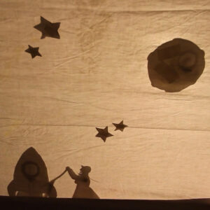 Shadow Puppets showing Gran, a rocket, stars and moon.