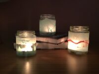 Photo showing 3 finished tea light holders displayed on some books.
