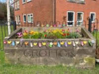 Welcome to Grotton sign decorated for Easter
