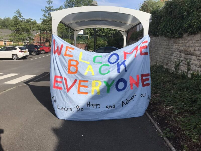 Banner showing Welcome Back Everyone in multi-colours and the phrase To Learn, Be Happy and Achieve our best