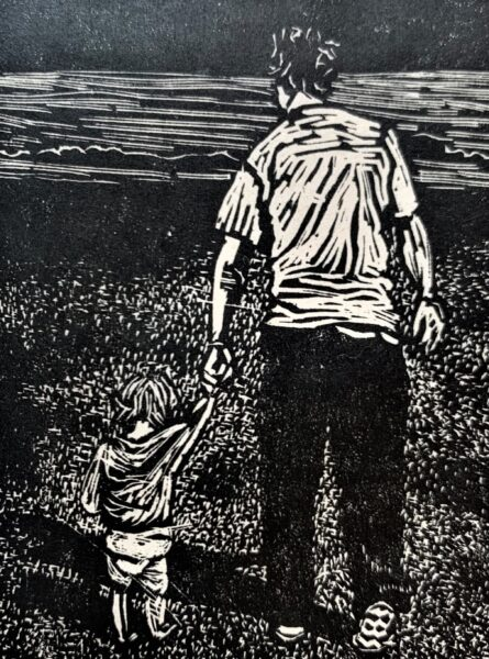 Toddler holding hands with an adult, walking towards the sea along a beach.