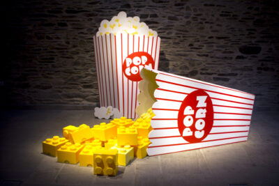 Two cartons of popcorn built from lego.