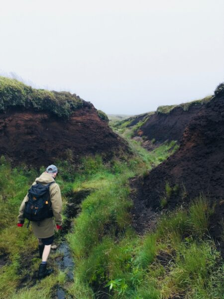 Adam Johnston standing in a deep Peat Gully