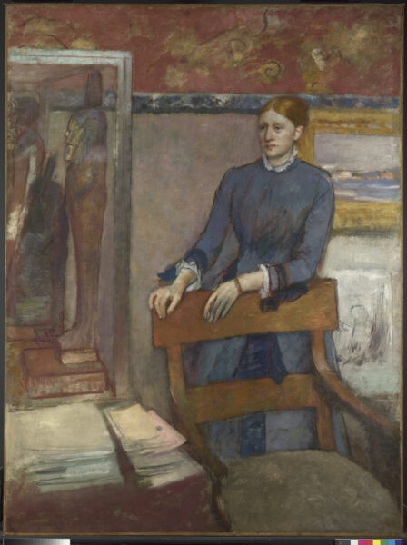 Painting of Hélène Rouart dressed in grey in her father's study stood leaning against his desk chair.